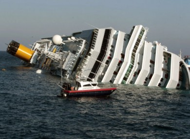 A Carabinieri boat approaches the luxury cruise ship Costa Concordia that ran aground the tiny Tuscan island of Giglio, Saturday, Jan. 14, 2012.