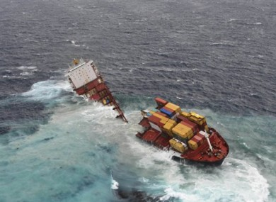 the stranded cargo ship Rena breaks in two pieces after overnight storms
