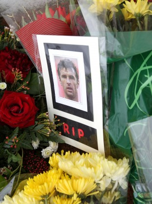 A photo left in respect of Wales manager Gary Speed outside the gates to Cardiff City's Ninian Park.