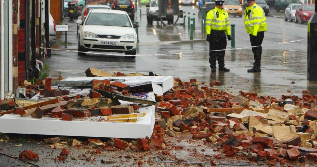 In pictures: storms topple trees and trucks in Britain