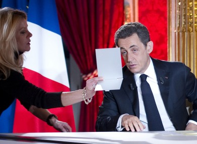 Nicolas Sarkozy looks in a mirror as he prepares for his interview on French TV last night.