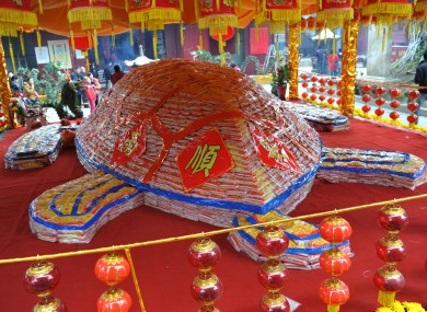 A rice tortoise, made of 50,000kg of rice, is displayed at Thean Hou Temple in Fujian, China