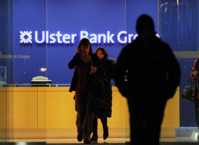 Staff leave Ulster Bank's headquarters at the IFSC on the day they were told that 600 jobs were being cut in the Republic of Ireland, with another 350 being lost in the North.
