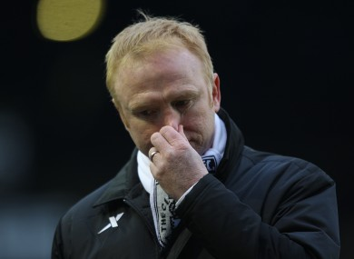 File photo of Alex mcLeish inspecting his nose
