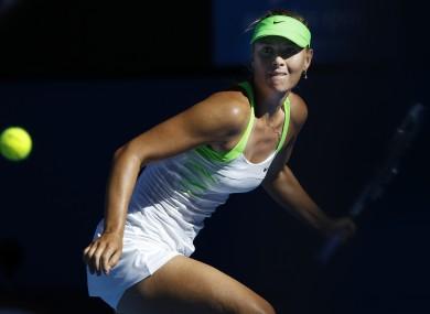 Maria Sharapova eyes on the ball for a return shot to Petra Kvitova.