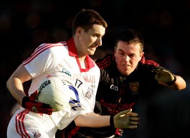 Jamie O'Sullivan (Cork) with Conor Garvey (Down)