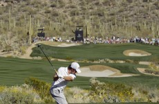 McIlroy and Westwood on course for duel in the desert