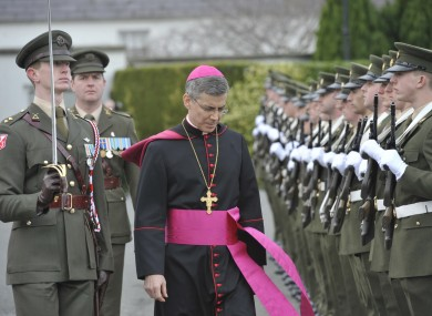 The new Papal Nuncio to Ireland, the Most Reverend Charles Brown, inspects a guard of honour at Áras an Úachtaráin.