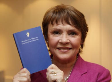 Presidential candidate from 2011, Dana Rosemary Scallon, holding a copy of Ireland's constitution.