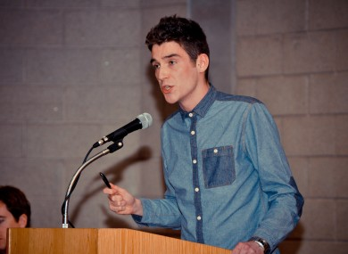 UCD Students' Union president Pat de Brún addresses last night's general meeting, the first of its kind for 24 years.