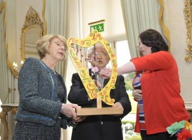 President Michael D Higgins and his wife Sabina meet with Margaret Doyle (right) of the Southside Travellers Action Group
