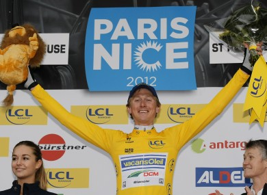 Sweden's Gustav Larsson reacts wearing the yellow jersey after winning the first stage time trial of Paris-Nice.