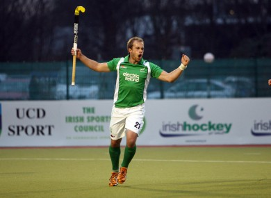 Timothy Cockram of Ireland celebrates scoring the first goal of the game.