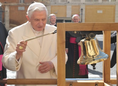 Pope Benedict XVI rings the bell of the International Eucharistic Congress, watched by (background) Fr Kevin Doran and Dr Diarmuid Martin.