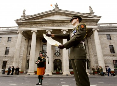 Captain Shane Keogh reads a copy of the original 1916 Proclamation of Independence at the GPO today, to mark the 96th anniversary of the 1916 Easter Rising.