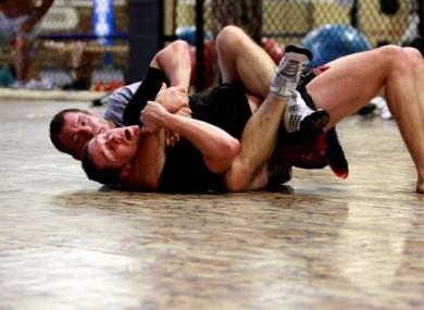 Damien 'The Rage' Rooney and Matt Hughes in action