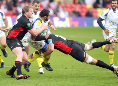 Saracens' Moutitz Botha tackles Clermont's Davit Zirakashvili