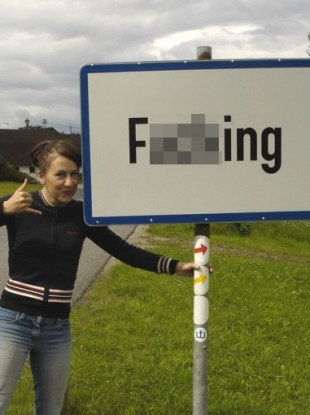 The Austrian village commands more than its fair share of visitors, who come to pose at its roadsigns.