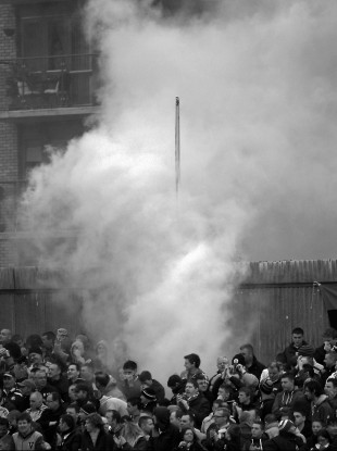 A flare goes off at Inchicore last Friday night in the Pat's-Hoops game.