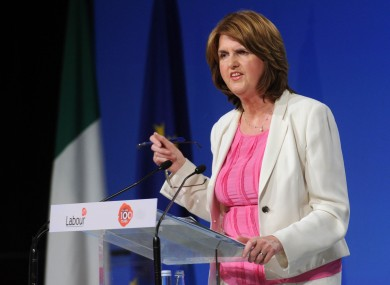Joan Burton argues that encouraging parents to enter the workforce is the best way of helping them to gain economically.
