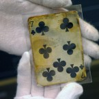 A seven of clubs card, one of the things recovered from the wreckage of the RMS Titanic. (AP Photo/Stanley Leary)