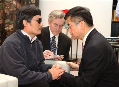 In this photo released by the US Embassy Beijing Press Office, blind lawyer Chen Guangcheng, left, talks with U.S. ambassador to China, Gary Locke