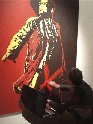 An unidentified man attacking the painting The Spear.