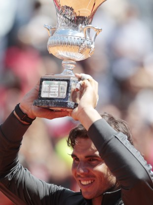 Rafael Nadal hoists the Italian Open trophy.