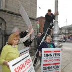 Deputy Dominic Hannigan falls off his ladder after putting up a Labour poster.   Photo: Sam Boal / Photocall Ireland