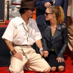 Johnny Depp honored with Hand & Footprint Ceremony at Grauman's Chinese Theatre in Hollywood, accompanied by Vanessa Paradis in September 2005. (Tammie Arroyo/UK Press/Press Association Images)