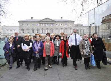 Symphysiotomy survivors with Sinn Fein Health spokesperson Caoimhghin O Caolain TD(left) and Gerry Adams, Sinn Fein Party leader (right) at a Dáil debate in March
