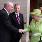 Queen Elizabeth II shakes hands with Northern Ireland Deputy First Minister Martin McGuinness watched by First minister Peter Robinson (centre) at the Lyric Theatre in Belfast. (Paul Faith/PA Wire)