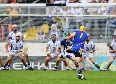 Clare goalkeeper Patrick Kelly attempts a shot on goal during the final moments of the match.