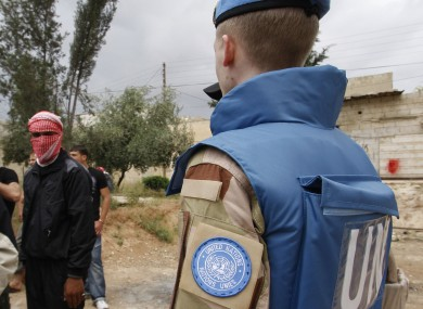 File photo: A UN observer and an anti-Syrian regime man in Hama city