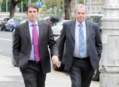 Sean Quinn (right) with his son Sean Jnr at the High Court this morning