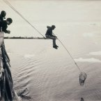 Hand-netting for macro-plankton from the Aurora during the first Australasian expedition. (Image: Frank Hurley)