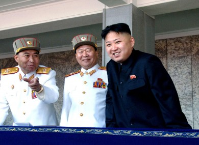 A photo from 15 April 2012 showing North Korean leader Kim Jong Un (right) with Ri Yong Ho on the left.