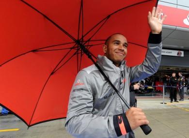 Vodafone McLaren Mercedes driver Lewis Hamilton walks down the pit lane.