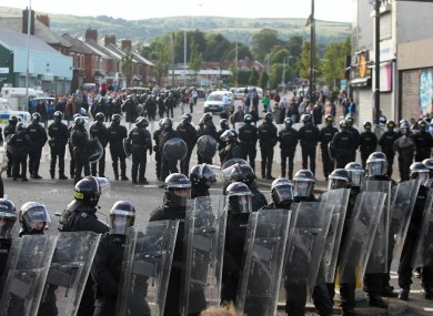Police line up against protesters in Ardoyne