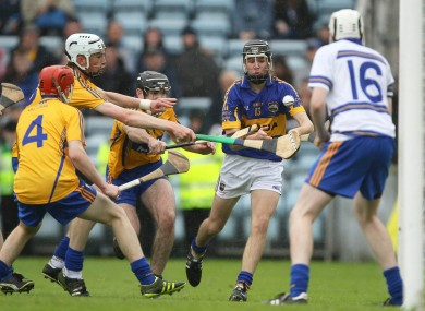 Tipperary's Mark McCarthy under pressure from by Gearoid Ryan, Colin Vaughan and Brian Carey of Clare.