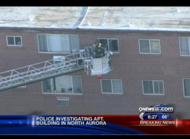 Police examine the gunman's apartment in North Aurora