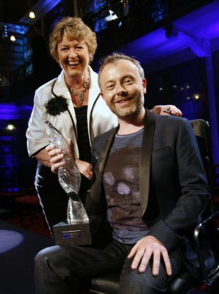 2FM's Rick O'Shea cradles his Celebrity Mastermind trophy, with host Nora Owen.