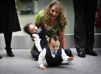 Angie Benhaffaf enjoys her playful twin sons Hassan and Hussein as they wait to meet Queen Elizabeth II on her visit to Cork last year.
