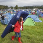 One festival-goes carrying her bed through the campsite. (Photo: Tony Kinlan)