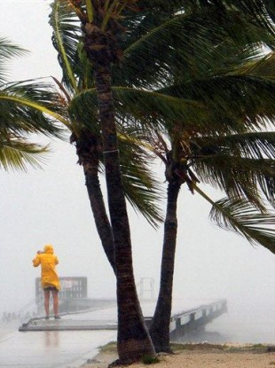 A person braves the rain at Clarence Higgs Beach in Key West, Florida.