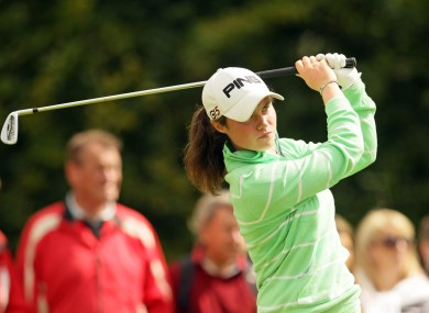 Leona Maguire studies her iron approach.