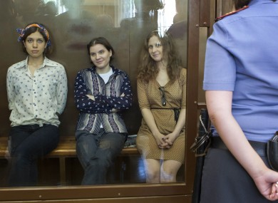 Nadezhda Tolokonnikova, Yekaterina Samutsevich and Maria Alekhina in a glass cage at the court room in Moscow on Friday