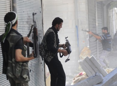 Free Syrian Army soldiers during clashes with Syrian government forces in Aleppo