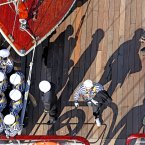 Sailors' shadows on the deck of the Cuauhtemoc as the ship prepares to sail out of Dublin Harbour.