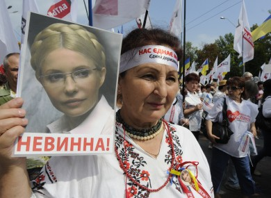 Opposition activists take part in a rally as they mark the 21th anniversary of Ukraine's independence from the Soviet Union and protest the arrest of former Prime Minister Yulia Tymoshenko in Kiev